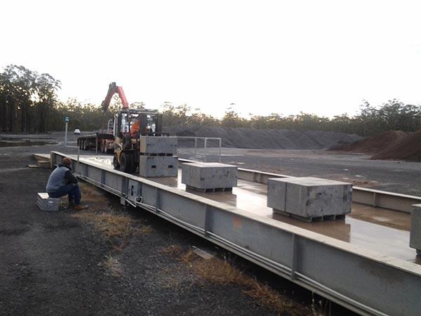SWIA technician calibrating weighbridge